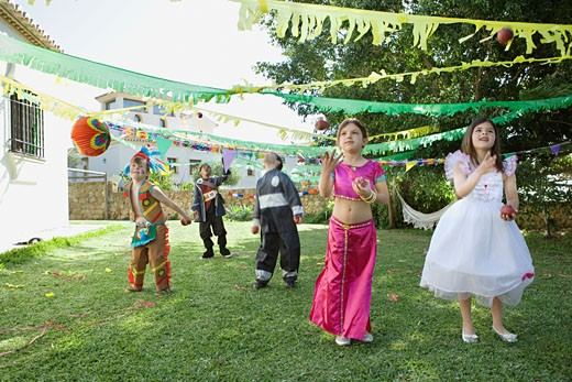 Stock Photo: 1775R-11348 Children in costume at birthday party