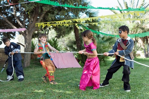Children in costume playing tug_of_war : Stock Photo
