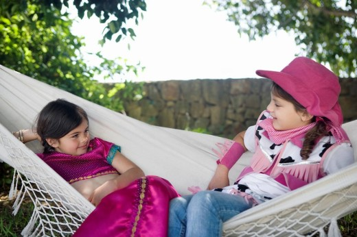 Stock Photo: 1775R-11354 Two young girls in costume sitting in hammock