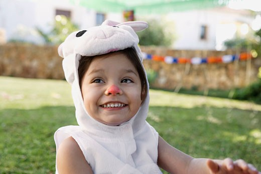 Young girl in rabbit costume : Stock Photo