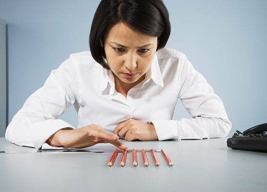 Stock Photo: 1775R-11496 Businesswoman carefully counting pencils