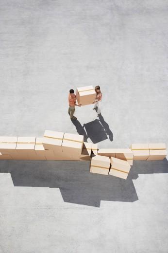 Couple stacking boxes : Stock Photo