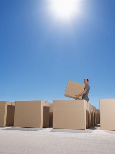 Man organized boxes : Stock Photo