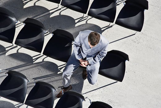 Businessman sitting in office chairs outdoors : Stock Photo