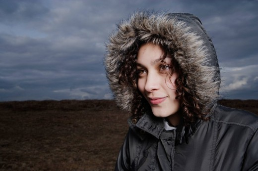 Teenage girl in fur hooded coat : Stock Photo