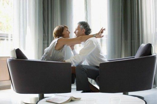 Couple hugging in modern hotel suite : Stock Photo
