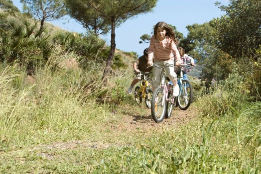 Stock Photo: 1775R-12538 Children riding bicycles in coastal park