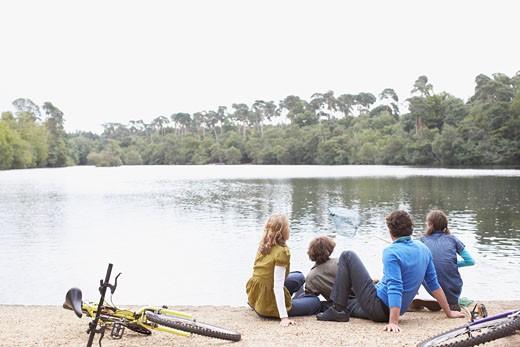 Stock Photo: 1775R-13002 Family sitting near lake