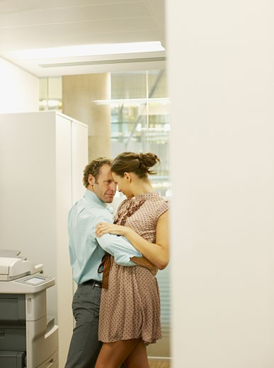 Stock Photo: 1775R-13189 Businesspeople dancing in copy room