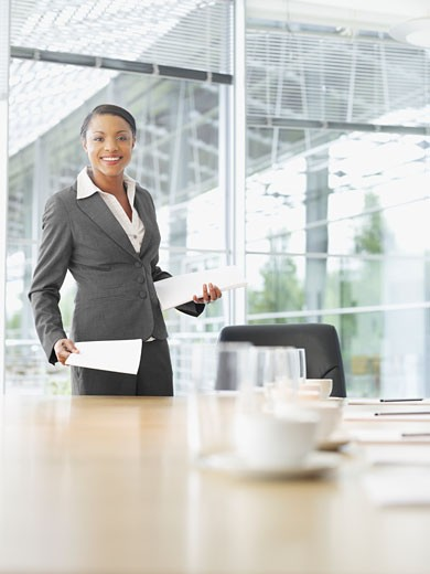 Businesswoman with paperwork in conference room : Stock Photo