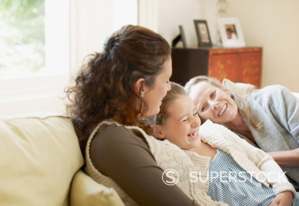Stock Photo: 1775R-13456 Family laughing on sofa