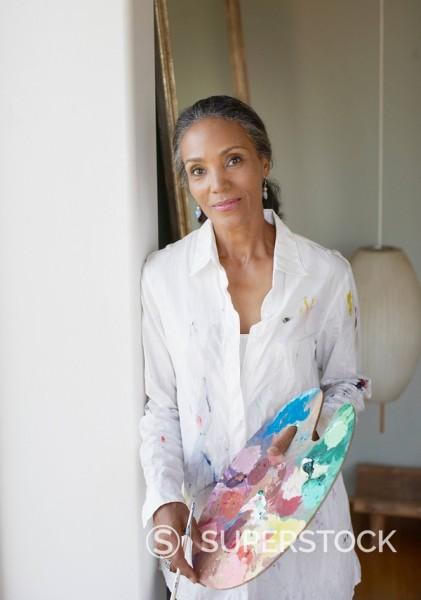 Stock Photo: 1775R-13704 Female painter holding paint palette