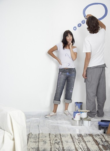 Man and woman painting thought bubble : Stock Photo