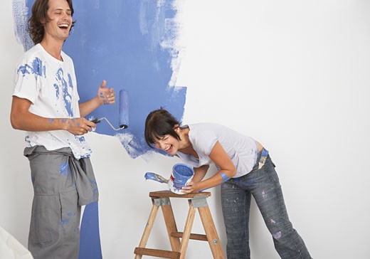 Stock Photo: 1775R-1387 Man and woman playing with paint