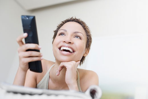 Woman watching television : Stock Photo