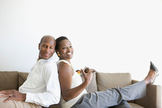 Stock Photo: 1775R-14043 Couple relaxing with music at home