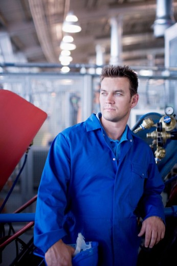 Stock Photo: 1775R-14382 Man in coveralls in workshop