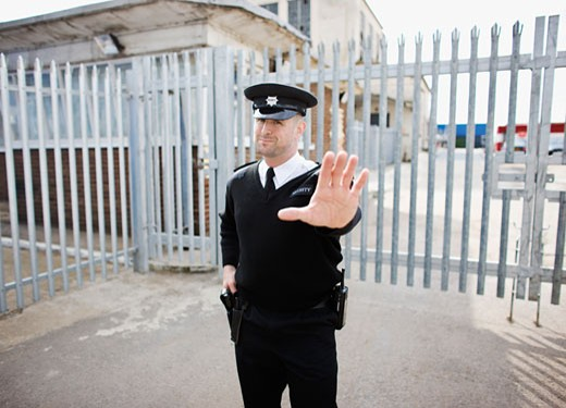 Stock Photo: 1775R-14390 Security guard holding hand out