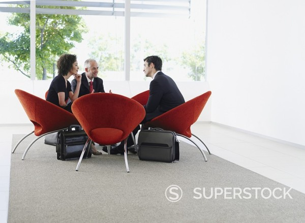 Stock Photo: 1775R-1448 Group of office workers in a meeting