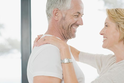 Mature couple hugging : Stock Photo