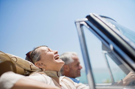 Stock Photo: 1775R-14646 Mature couple driving in convertible