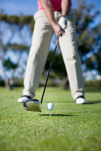 Close up of golf club about to hit golf ball : Stock Photo