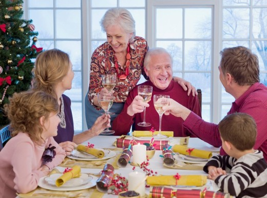 Multi_generation family toasting at Christmas dinner : Stock Photo