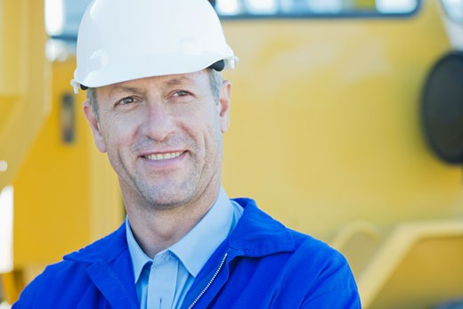 Construction worker in hard_hat smiling : Stock Photo
