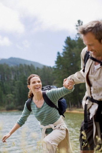Stock Photo: 1775R-15926 Couple hiking near lake in remote area