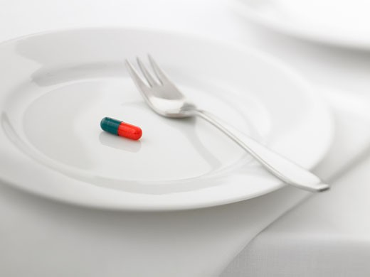 Close up of pill capsule on plate : Stock Photo