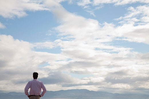 Businessman looking at sky : Stock Photo