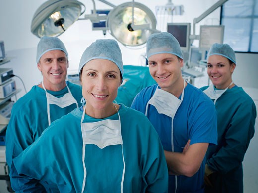 Team of surgeons in operating room : Stock Photo