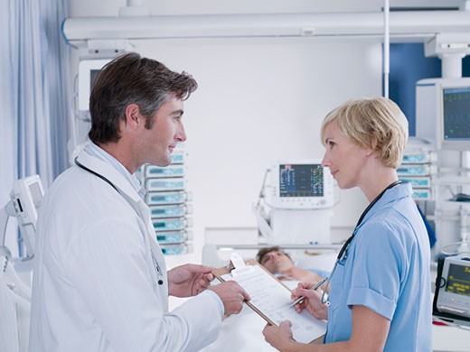 Stock Photo: 1775R-16753 Doctor and nurse talking in intensive care