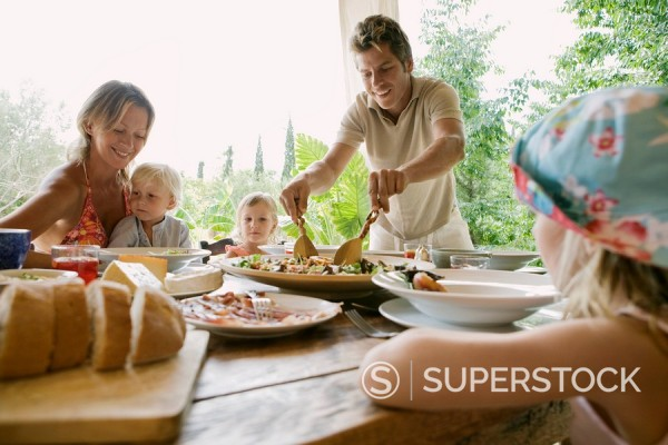 Family eating dinner : Stock Photo