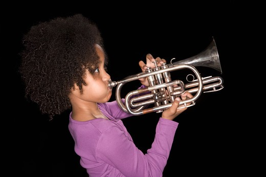 Stock Photo: 1775R-17953 Girl playing trumpet