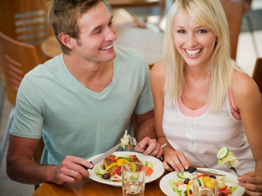 Couple eating at cafe : Stock Photo