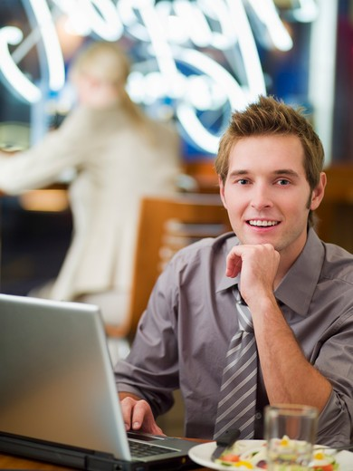Businessman using laptop at cafe : Stock Photo