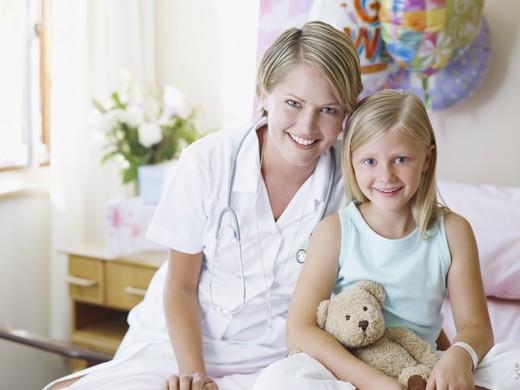Stock Photo: 1775R-1848 Girl with teddy bear and nurse in hospital