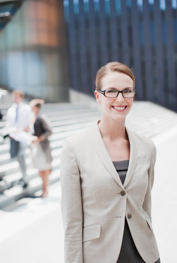 Smiling businesswoman standing outdoors : Stock Photo