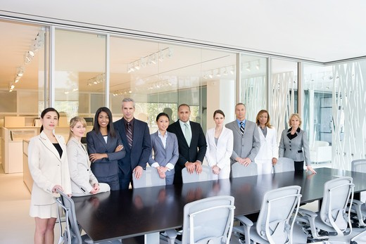 Business people standing in conference room : Stock Photo