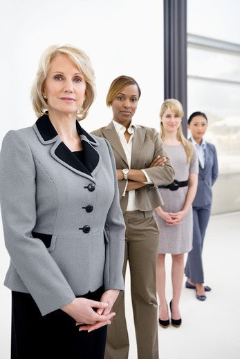 Businesswomen standing in office : Stock Photo