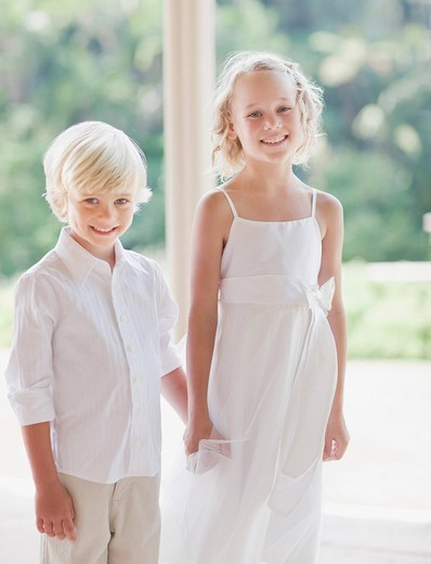 Flower girl and boy at wedding reception : Stock Photo