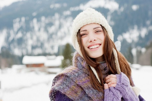 Stock Photo: 1775R-19361 Woman in cap, scarf and gloves in snow