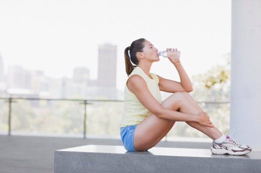Stock Photo: 1775R-19393 Woman drinking water after exercise