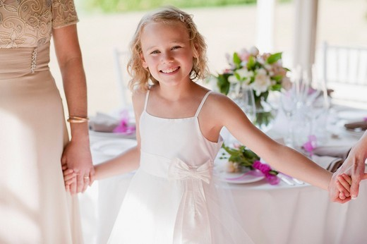 Family holding hands at wedding reception : Stock Photo