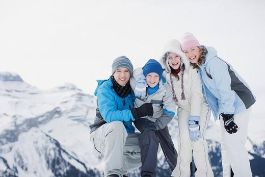 Family on snowy mountain top : Stock Photo