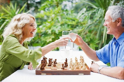 Couple playing chess outdoors : Stock Photo