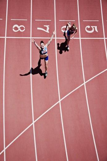 Winning runner cheering on track : Stock Photo
