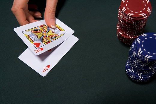 Stock Photo: 1775R-20005 Woman playing blackjack in casino