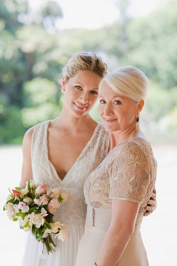 Mother and bride hugging : Stock Photo
